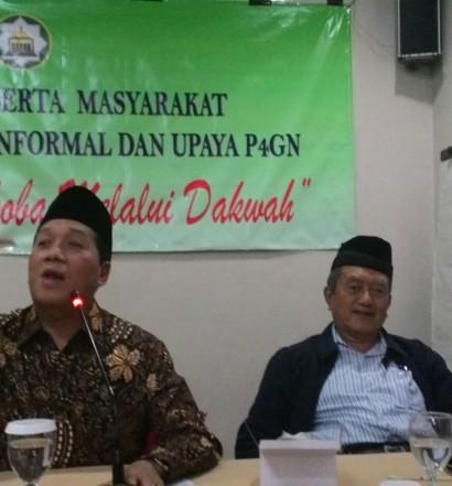 Sumber: www.dmi.or.id / Sekjen PP DMI, Drs. H. Imam Addaruquthni, MA., (kiri)